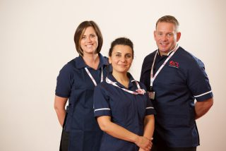 Three proud members of ECL staff from West Sussex standing together. One male and two females.