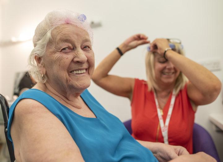 Older person getting their hair cut.