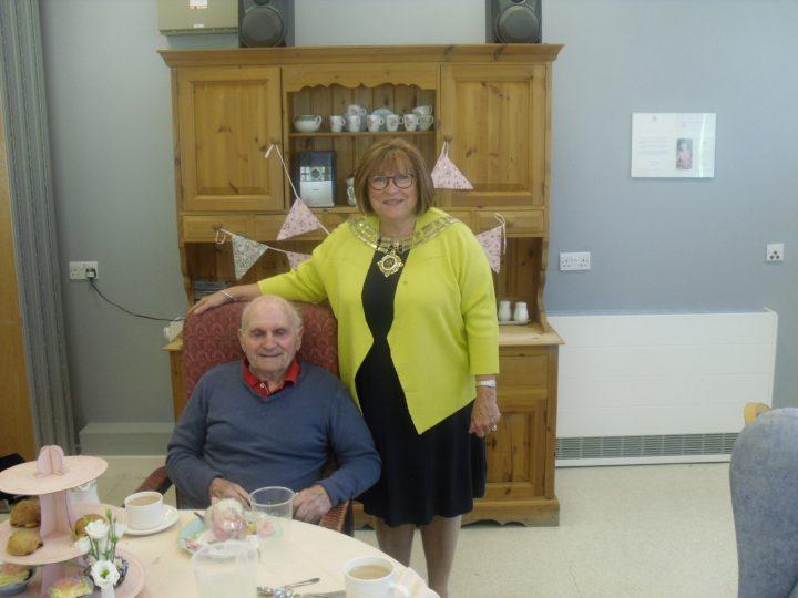 The Mayor Elect, Councillor Sheila Murphy standing alongside a customer.