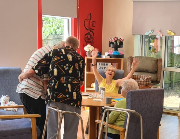 An image of customers enjoying themselves, and being cared for in a pleasant environment.