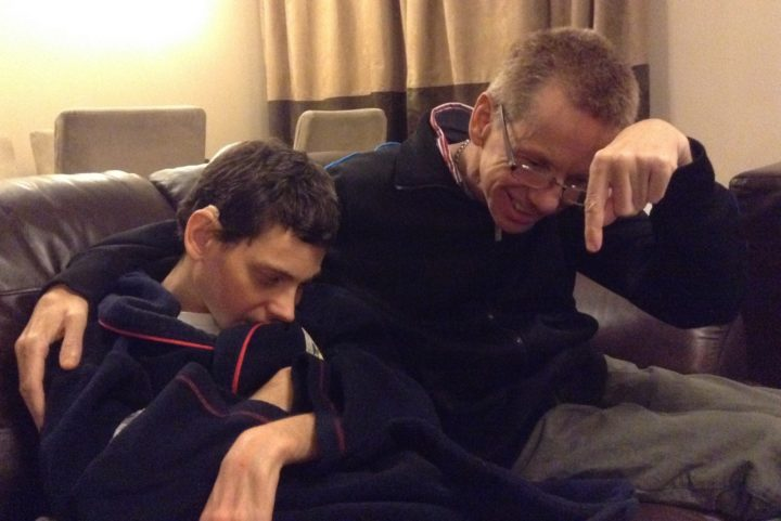 Image of two adult male siblings with learning disabilities and impaired eyesight