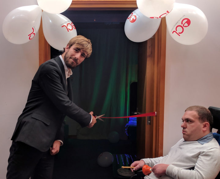 Stephen Canning cutting ribbon with customer Jonathan Bowen