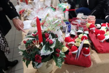 ECL Christmas Fayre stall with flowers and sweets in miniature hats.