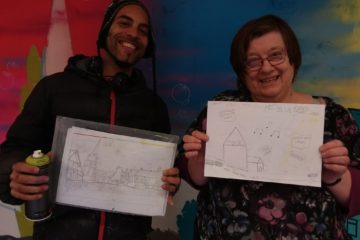 Artists hold up their graffiti designs for ECL event.
