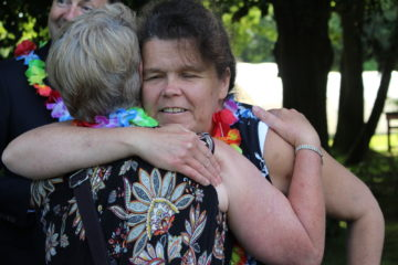 Sensory impaired volunteers embracing at awards ceremony