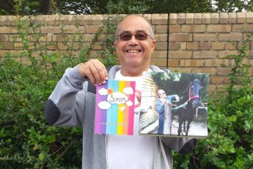 ECL Simon presents a card and image of him attending a horse.